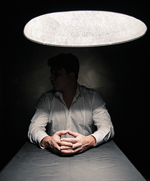 Man sitting in interrogation room