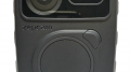 Close up of a body worn camera is shown.