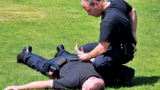 Officer arrested a man lying on the ground.