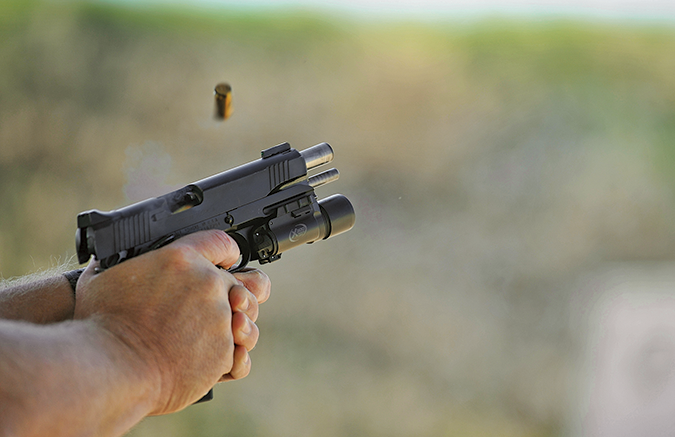 Pistol in two hands.