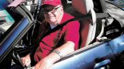 Bill Siuru sitting inside a car.