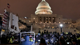 Capitol building during riot at night.