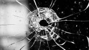 Bullet hole break in a window.