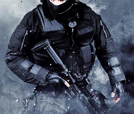 Male wearing dark uniform carrying a weapon.