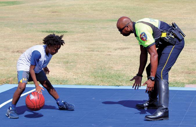 Two men playing basketball.