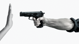 Hand pointing a pistol.